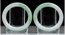A Pair of Chinese Carved Jadeite Bangles 3-1/4 inches diameter (8.3 cm)