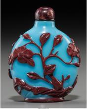 A Fine Chinese Cinnabar Red Overlay Sky Blue Glass Snuff Bottle, Qing Dynasty, 1