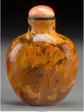 A Chinese Polished Realgar Glass Snuff Bottle, Qing Dynasty 2-1/4 inches high (5