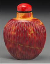 A Chinese Realgar Glass Basketweave Snuff Bottle, Qing Dynasty 2-5/8 inches high