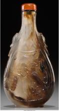 A Chinese Carved Shadow Agate Snuff Bottle 3-1/2 inches high (8.9 cm)   The flat