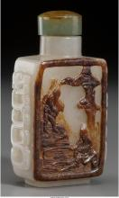 A Chinese White and Pebbled Brown Silhouette Jade Snuff Bottle, Qing Dynasty, 18