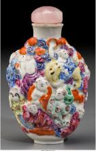 A Chinese Molded Porcelain Eighteen Luohan Snuff Bottle Qianlong four-character