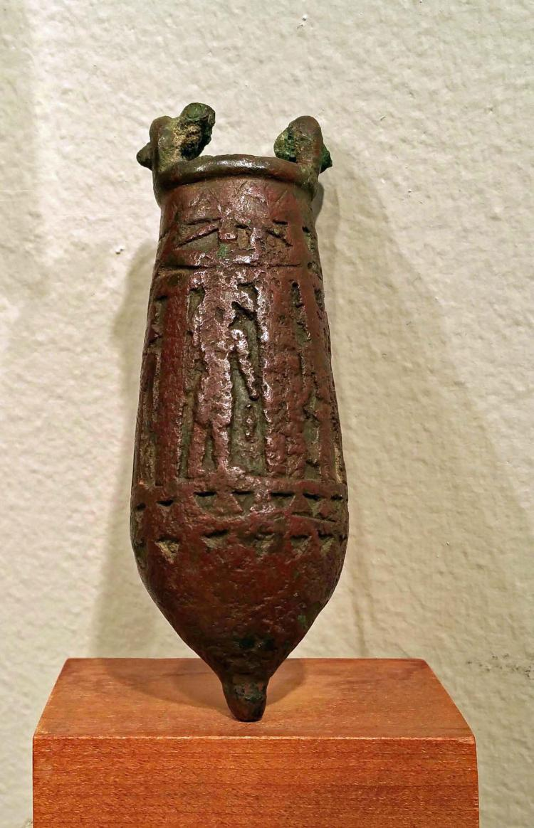 AN ANCIENT EGYPTIAN BRONZE SITULA .