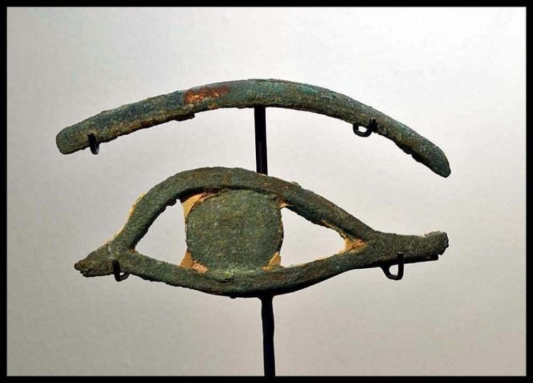 AN ANCIENT EGYPTIAN BRONZE EYE AND EYEBROW