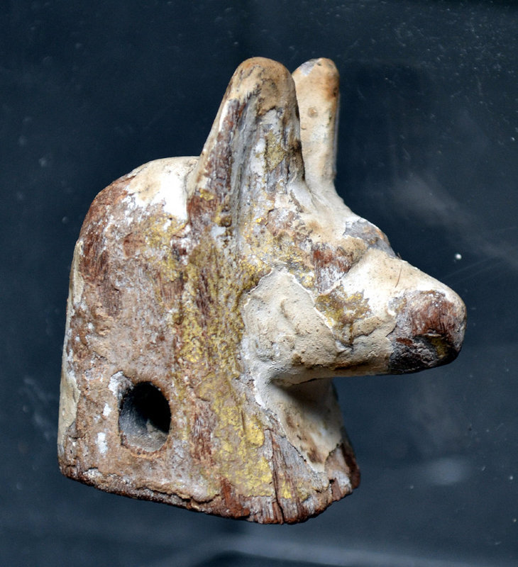 AN ANCIENT EGYPTIAN WOOD HEAD OF ANUBIS .