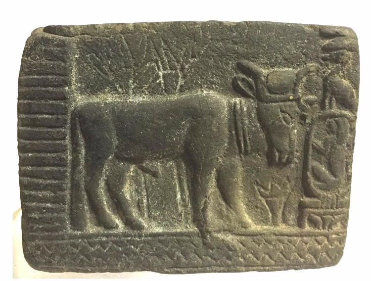 Ancient Egyptian relief terracotta sculpture bull.