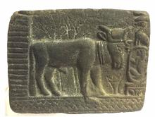 Ancient Egyptian relief terracotta sculpture bull.
