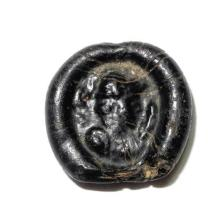 Roman Empire molded glass Token or Amulet