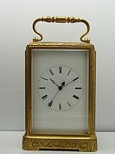 Antique French Brass Ornately Engraved Carriage Clock. Neat piece of Horse-drawn, pre 1900s history and VERY collectible. Comes with key.