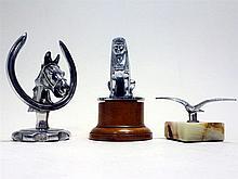 Three Car Mascots