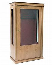 † A NEW AND UNUSED GLASS-FRONTED GUN CABINET,