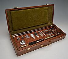 † A NEW AND UNUSED CASED PRESENTATION DELUXE GUN 12-BORE CLEANING KIT,