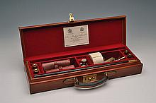A LEATHER CASED 20/12-BORE SHOTGUN CLEANING-KIT,