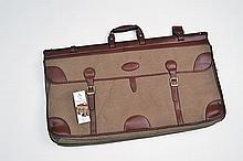 † GUARDIAN A NEW AND UNUSED LARGE CANVAS AND LEATHER TRAVEL BAG,