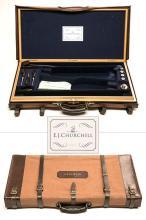 E.J. CHURCHILL A BRASS-CORNERED OAK AND LEATHER DOUBLE GUNCASE,
