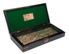 A BRASS-BOUND WALNUT CASE FOR A PAIR OF DUELLING-PISTOLS WITH 'WESTLEY-RICHARDS' TRADE-LABEL,