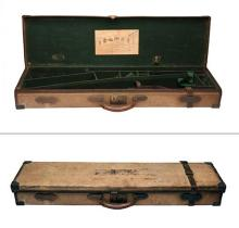CHARLES LANCASTER A BRASS-CORNERED CANVAS AND LEATHER TAKE-DOWN RIFLE CASE,