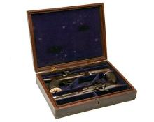 A CASED PAIR OF 30-BORE PERCUSSION SAW-HANDLED PISTOLS, UNSIGNED, no visible serial numbers,