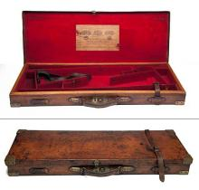 JOSEPH LANG AND SON A BRASS-CORNERED OAK AND LEATHER DOUBLE GUNCASE,