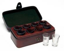 † REY PAVON A NEW AND UNUSED BEST QUALITY LEATHER-CASED SET OF EIGHT SHOT GLASSES,