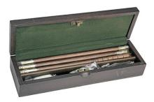 † A NEW AND UNUSED OAK CASED 'PRESENTATION' 12-BORE GUN CLEANING KIT,