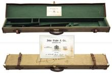 JOHN RIGBY & CO. A BRASS CORNERED CANVAS AND LEATHER FULL-LENGTH RIFLE CASE,