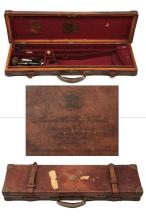 JAMES PURDEY & SONS A BRASS-CORNERED OAK AND LEATHER SINGLE GUNCASE,