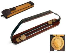 † JAMES PURDEY & SONS A NEW AND UNUSED CASED BRASS AND ROSEWOOD GAME CARRIER,