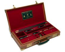 † JAMES PURDEY & SONS A BRASS-CORNERED HANDMADE LEATHER GUN CLEANING KIT,