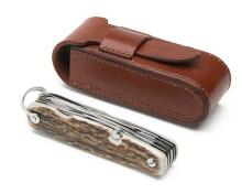 † JAMES PURDEY & SONS A NEW AND UNUSED STAG HORN MULTI-TOOL POCKET KNIFE,