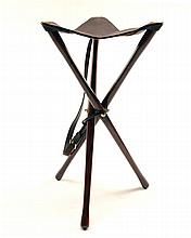 † JAMES PURDEY & SONS LTD. A NEW AND UNUSED LIGHTWEIGHT WOOD AND LEATHER TRIPOD SEAT,