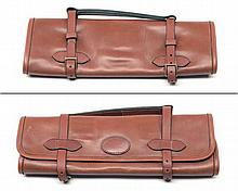 A NEW AND UNUSED LEATHER SUEDE-LINED GUN CLEANING KIT ROLL,