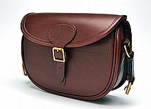 † JAMES PURDEY & SONS A NEW AND UNUSED LEATHER SUEDE-LINED CARTRIDGE BAG,