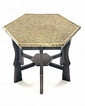 A VINTAGE HEXAGONAL TABLE INLAID WITH PERIOD CARTRIDGE HEADSTAMPS,