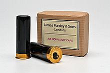 † JAMES PURDEY & SONS A NEW AND UNUSED PAIR OF BRASS AND HORN 20-BORE SNAP CAPS,