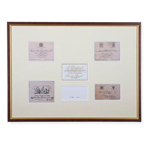 † A FRAMED COLLECTION OF JAMES PURDEY & SONS TRADE / CASE LABELS,