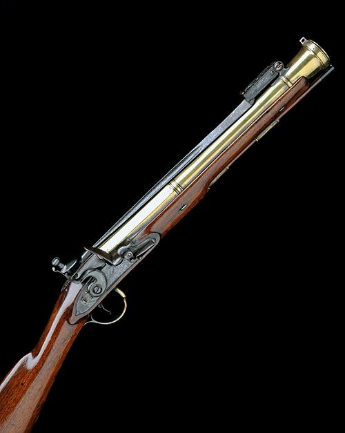 T. RICHARDS, LONDON A GOOD 20-BORE FLINTLOCK BRASS BARRELLED BLUNDERBUSS WITH SPRUNG BAYONET, no visible serial number,