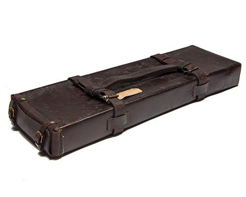 A LEATHER OUTER FOR A VINTAGE DOUBLE GUNCASE,
