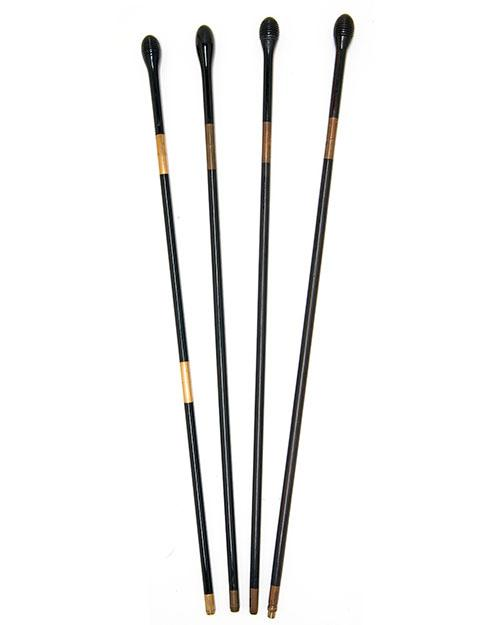A COLLECTION OF FOUR VINTAGE EBONY AND BRASS GUN-CLEANING RODS,