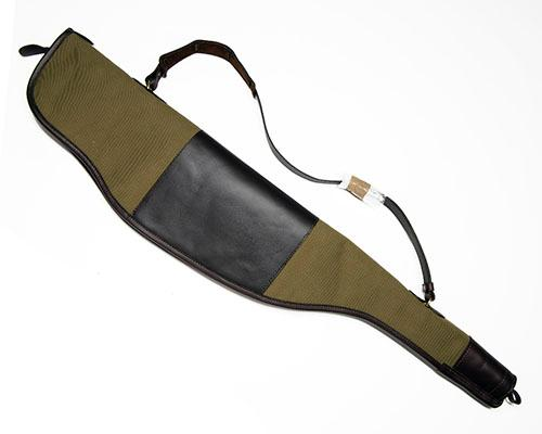 HOLLAND & HOLLAND AN UNUSED KHAKI CANVAS AND LEATHER FLEECE-LINED SINGLE RIFLE SLIP,