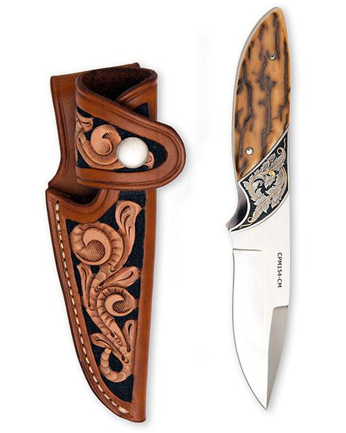 TRACEY MICKLEY, USA A JOE MASON ENGRAVED AND GOLD INLAID SPORTING KNIFE,