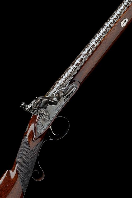 A FINE 28-BORE FLINTLOCK SINGLE-BARRELLED SPORTING GUN WITH SILVER KOFTGARI-WORK BARREL, SIGNED FOTHERBY, no visible serial number,