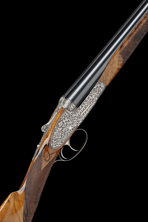 LUCIANO BOSIS A FINE, PEDRETTI-ENGRAVED 20-BORE PINLESS SIDELOCK EJECTOR, serial no. 452,