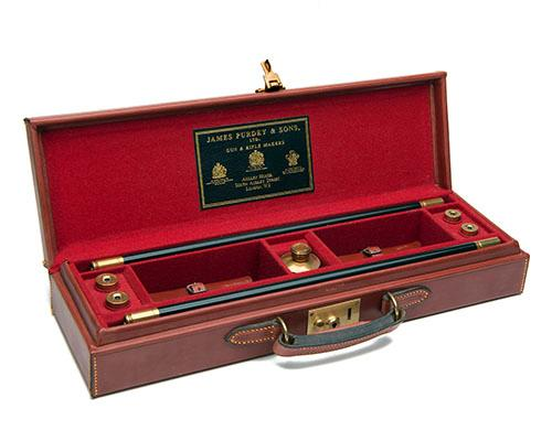JAMES PURDEY & SONS A VIRTUALLY UNUSED LEATHER CASED GUN-CLEANING KIT,