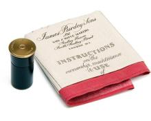 JAMES PURDEY & SONS A PLACE FINDER IN THE FORM OF A 4-BORE CARTRIDGE TOGETHER WITH A HANDKERCHIEF,