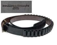 HOLLAND & HOLLAND TWO BRASS AND LEATHER CARTRIDGE BELTS,