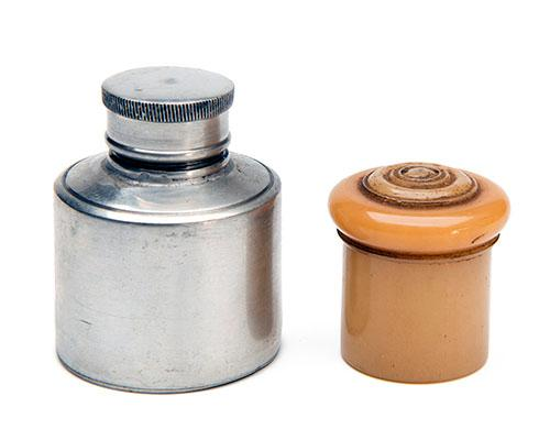 A PEWTER GUNCASE OIL BOTTLE AND A BONE STRIKER POT