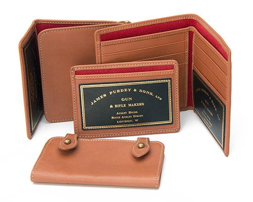JAMES PURDEY & SONS A COLLECTION OF MATCHING LEATHER POCKET ACCESSORIES,