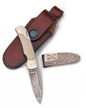 JAMES PURDEY & SONS A STERLING SILVER MONEY CLIP TOGETHER WITH A FOLDING POCKET KNIFE,